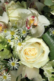 Orchids and roses in bridal bouquet Royalty Free Stock Images
