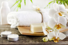 Orchids and towel on wooden boards Royalty Free Stock Photo