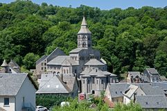 Orcival, France. Romanesque basilica  in village Orcival, Auvergne, France Stock Photography