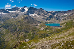 Orco Valley, the Serru lake and Gran Carro Mountains. The Orco Valley is in the National Park Gran Paradiso, in bottom the house of the guard Royalty Free Stock Image