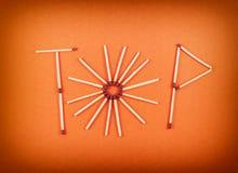 OrdÖVERKANT som göras av matchsticks Arkivbild