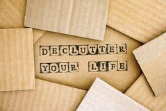 Ord Declutter som ditt liv gör vid svarta alfabetstämplar på cardb fotografering för bildbyråer