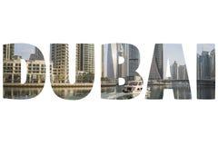 Ord DUBAI över symboliska ställen Arkivfoton