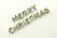 Ord för glad jul från färgrika bollar på vit bakgrund Arkivfoto