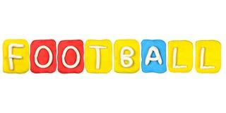 Ord FOTBOLL för plastellinaalfabetform Arkivbild