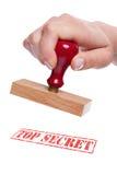 ord för överkant för stämpel för sekund för handholding rubber Fotografering för Bildbyråer