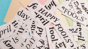 Ord lyckliga April Fools Day på färgrik bakgrund Fotografering för Bildbyråer