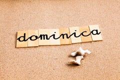 Ord på sand Dominica Arkivfoto