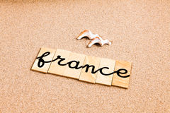 Ord på sand Frankrike Royaltyfri Bild