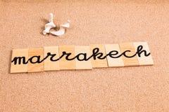 Ord på sand marrakech Arkivbild