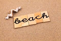 Ord på sandstranden Fotografering för Bildbyråer
