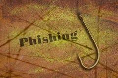 Ord Phishing och en krok Arkivfoto