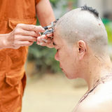 Ordained. Shaved to ordained in Buddhism stock images