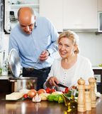 Ordatary mature couple cooking healthy food Stock Photos