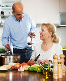 Ordatary mature couple cooking soup Royalty Free Stock Photography
