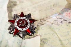 Orde van de Patriottische Oorlogs 1st klasse op brieven van de Voorzijde Stock Foto