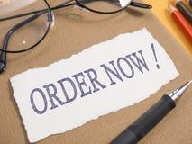 A ordem agora, palavras de mercado do negócio cita o conceito imagem de stock royalty free