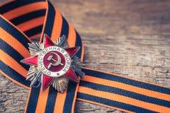 A ordem soviética da segunda guerra mundial e do George fita Victory Day conceito do cartão do 9 de maio Imagens de Stock Royalty Free