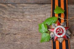A ordem soviética da segunda guerra mundial e do George fita Victory Day conceito do cartão do 9 de maio Fotografia de Stock Royalty Free