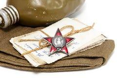 Orden de la estrella roja, de las fotografías viejas, del casquillo de campo y del frasco Posición Foto de archivo libre de regalías