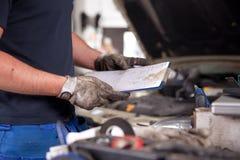 Orden del servicio del mecánico Fotos de archivo