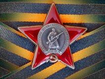 Orden do ` vermelho da estrela do ` na fita do ` s de St George closeup Concede o avô heirloom memória foto de stock