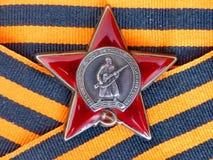Orden do ` vermelho da estrela do ` na fita do ` s de St George closeup Concede o avô heirloom memória foto de stock royalty free