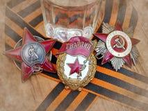Orden do ` vermelho da estrela do `, sinal do ` guarda o ` e o Orden ` patriótico da guerra do ` do grande na fita do ` s de St G foto de stock royalty free