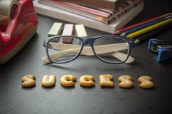 Orden: framgång som göras av kakor. Royaltyfri Fotografi