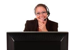 Ordenador de la mujer del puesto de informaciones Fotos de archivo libres de regalías