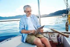 Ordenador de la tableta en el barco Fotos de archivo