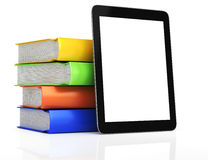 Ordenador de la tablilla y pila de libros Imagen de archivo libre de regalías