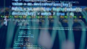 Ordenador de trabajo con un código en una pantalla almacen de metraje de vídeo