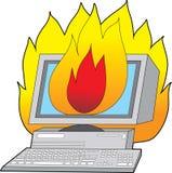 Ordenador en el fuego Imagen de archivo libre de regalías