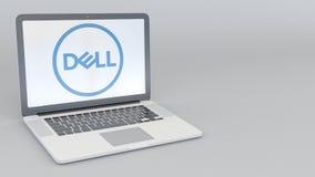 Ordenador portátil con Dell Inc LOGOTIPO Representación conceptual del editorial 3D de la informática Imagen de archivo
