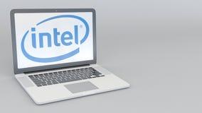 Ordenador portátil con el logotipo de Intel Corporation Representación conceptual del editorial 3D de la informática stock de ilustración