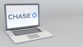 Ordenador portátil con el logotipo de JPMorgan Chase Bank Representación conceptual del editorial 3D de la informática Fotos de archivo
