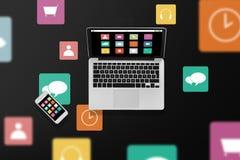 Ordenador portátil con los iconos y smartphone del menú Foto de archivo libre de regalías