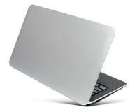 Ordenador portátil de aluminio fino que vuela, vista posterior, en un blanco Imágenes de archivo libres de regalías