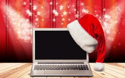 Ordenador portátil de Papá Noel Imagenes de archivo
