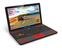 Ordenador portátil del videojugador con el videojuego Fotografía de archivo