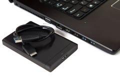 Ordenador portátil, disco duro externo del USB y Memory Stick Imagenes de archivo