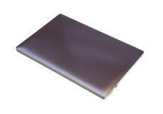 Ordenador portátil en el fondo blanco Foto de archivo libre de regalías
