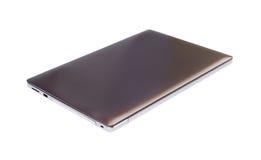 Ordenador portátil en el fondo blanco Imagen de archivo
