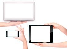 Ordenador portátil, tableta digital y teléfono móvil con la mano Foto de archivo