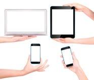 Ordenador portátil, tableta digital y teléfono móvil con la mano Imagen de archivo