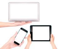 Ordenador portátil, tableta digital y teléfono móvil con la mano Imagenes de archivo