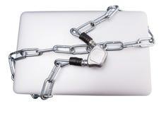 Ordenador portátil y cadenas IV fotografía de archivo
