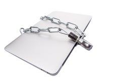 Ordenador portátil y cadenas IX foto de archivo