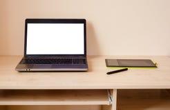Ordenador portátil y tableta de gráficos Foto de archivo libre de regalías